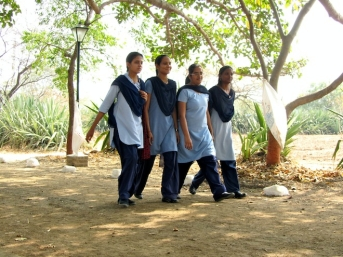 School girls wearing their uniform.