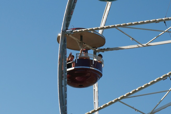 A Ferris Wheel seat containing two lads in Rainier, Oregon.