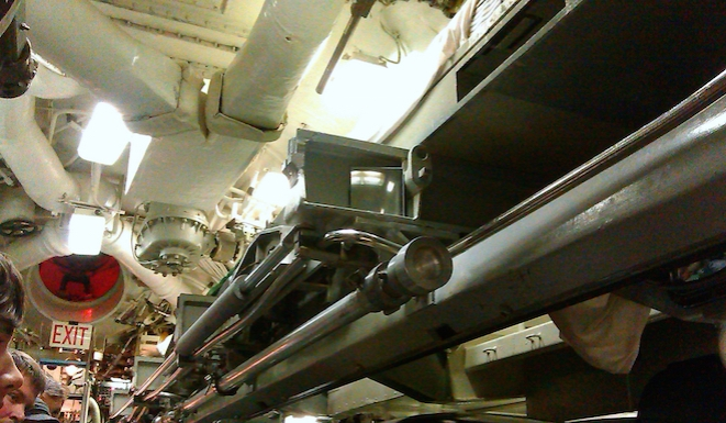 On the top right you may be able to see a small mattress. Some of the crew chose to sleep/nap in the torpedo room because it was the most ventilated room in the submarine.